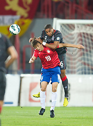NOVI SAD, SERBIA - Tuesday, September 11, 2012: Wales' Ashley Williams in action against Serbia's Filip Duricic during the 2014 FIFA World Cup Brazil Qualifying Group A match at the Karadorde Stadium. (Pic by David Rawcliffe/Propaganda)