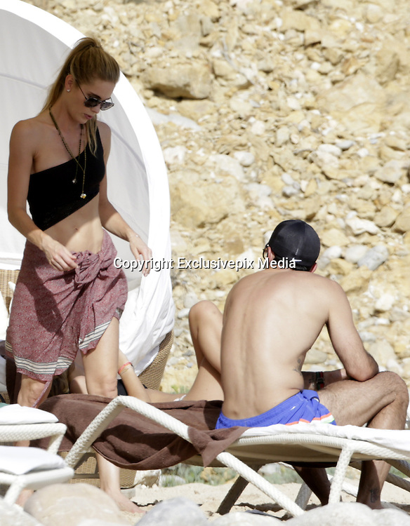 IBIZA, SPAIN, 2016, JUNE 29 <br /> <br /> Luis Figo has again chosen the island of Ibiza to enjoy his summer vacation with his wife, Helen Svedin, and their three daughters, Daniela, Martina and Stella. The couple arrived to the Balearic island on a yacht. We can see how they enjoy the crystal clear waters of Ibiza, his daughters are as beautiful as the mother and are very aware of his father. A very close family, enjoying a nice holiday in Ibiza and Formentera iIslas. He has been portrayed arrival at the beach in jeans and shirt, which quickly changed to a more beachy bikini and sunglasses look. The whole family enjoy a swim, where we could see that it was player keeps his athletic body and the model is not indifferent to the great guy that looks. Luis I take the quiet of the beach to enjoy reading.<br /> &copy;Exclusivepix Media