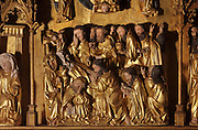 The Death of the Virgin, with the apostles surrounding her body, from the Altarpiece of the Virgin, 1430-40, in the Eglise de Saint-Roch, Ternant, Nievre, Burgundy, France. An angel reaches up to close the Virgin's eyes, and 2 other angels take her soul, in the form of a child, up to heaven. The altarpiece was commissioned by Philippe de Ternant and his wife Isabeau de Roye, and depicts 7 scenes of the Life of the Virgin, both painted and sculpted, including the Annunciation, Dormition and Glorification. It was made by Brabant and Flemish workshops in painted and gilded carved wood. The altarpiece has been restored many times and is listed as a historic monument. Picture by Manuel Cohen