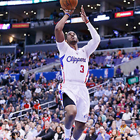24 March 2014: Los Angeles Clippers guard Chris Paul (3) goes for the layup during the Los Angeles Clippers 106-98 victory over the Milwaukee Bucks at the Staples Center, Los Angeles, California, USA.