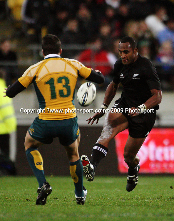 Joe Rokocoko chips over Adam Ashley-Cooper.<br /> Investec Tri-Nations - All Blacks v Australia at Westpac Stadium, Wellington. Saturday 19 September 2009. Photo: Dave Lintott/PHOTOSPORT