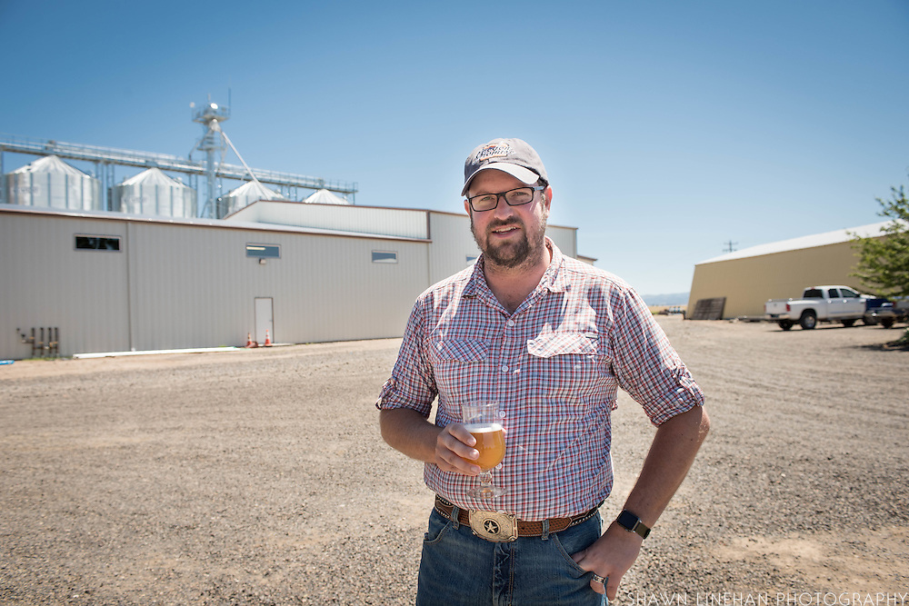Seth Klann in front of the malting facility at his family farm, Mecca Grade Estate Malt, in Madras, Oregon.
