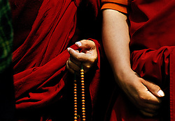 China, Beijing, 2007. Wooden prayer beads are a study in simplicity. Among the monks making pilgrimages to Yong He Gong, they are in constant use..
