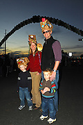 A family of revelesr at the Grand Procession on New Year's Eve in Austin Texas as part of the First Night 2009 celebration, December 31, 2008. First Night is an annual celebration of the arts  held on New Year's Eve in Austin Texas.