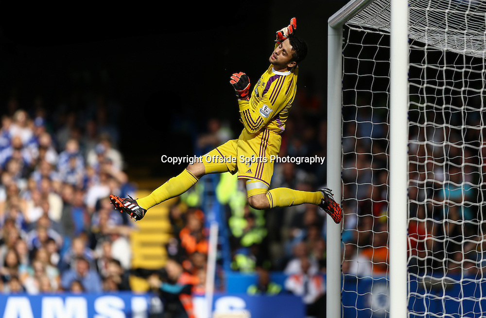 13 September 2014 - Barclays Premier League - Chelsea v Swansea City - Lukasz Fabianski of Swansea City tips a shot over the crossbar - Photo: Marc Atkins / Offside.