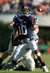 Virginia quarterback Jameel Sewell (10) throws a shovel pass to Virginia tight end Jonathan Stupar (88)...The Virginia Cavaliers defeated the Connecticut Huskies 17-16 at Scott Stadium in Charlottesville, VA on October 13, 2007