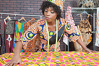 An African American female fashion designer working on a pattern cloth