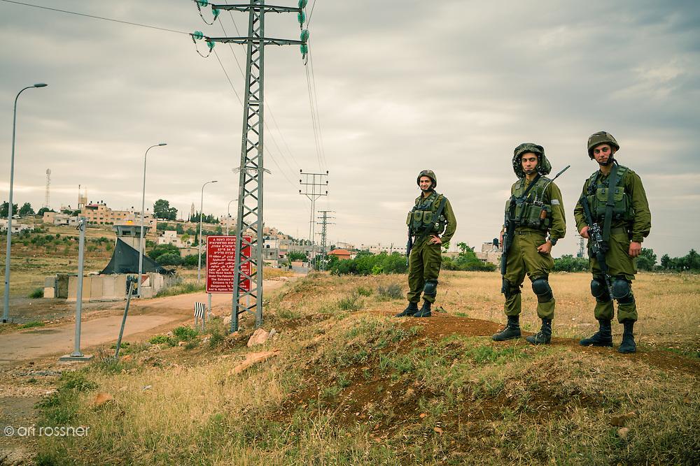 Israeli soldiers near a Palestinian village