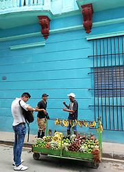 Tourist buying fruits. Old Havana, Cuba. Havana vieja, street.