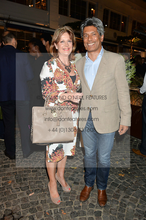 Bluebird owner DES GUNEWARDENA and his wife LIZ at the Bluebird's End of Summer Party with Taylor Morris held at Bluebird, 350 King's Road, London on 29th September 2016.