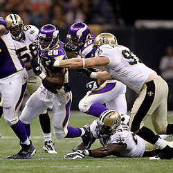 September 9, 2010; New Orleans, LA, USA;  Minnesota Vikings running back Adrian Peterson (28) is pursued by New Orleans Saints defensive end Jeff Charleston (97) and defensive lineman Anthony Hargrove (69) during the NFL Kickoff season opener at the Louisiana Superdome. The New Orleans Saints defeated the Minnesota Vikings 14-9.  Mandatory Credit: Derick E. Hingle
