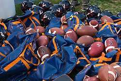 Nov 26, 2011; Charlottesville VA, USA;  General view of footballs, football bags and Virginia Cavaliers helmets on the sidelines during the second quarter against the Virginia Tech Hokies at Scott Stadium.  Virginia Tech defeated Virginia 38-0. Mandatory Credit: Jason O. Watson-US PRESSWIRE