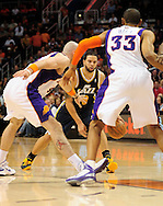 Feb. 15, 2011; Phoenix, AZ, USA; Utah Jazz guard Deron Williams (8) handles the ball against the Phoenix Suns center Marcin Gortat (4) and teammate Grant Hill (33) at the US Airways Center.  The Suns defeated the Jazz 102-101. Mandatory Credit: Jennifer Stewart-US PRESSWIRE