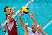 (L) Evgeny Sivozhelev from Russia in action during the 2013 CEV VELUX Volleyball European Championship match between Russia v Slovakia at Ergo Arena in Gdansk on September 24, 2013.<br /> <br /> Poland, Gdansk, September 24, 2013<br /> <br /> Picture also available in RAW (NEF) or TIFF format on special request.<br /> <br /> For editorial use only. Any commercial or promotional use requires permission.<br /> <br /> Mandatory credit:<br /> Photo by &copy; Adam Nurkiewicz / Mediasport