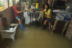 January 2, 2018 - Bais, Negros Oriental, Philippines - An elderly man and a woman eat in their flowed kitchen. Tropical Depression Agaton hits, as the first typhoon of the year.  They thought it was a weak storm but it dumped more rains. (Credit Image: © Joseph C. Ceriales/Pacific Press via ZUMA Wire)
