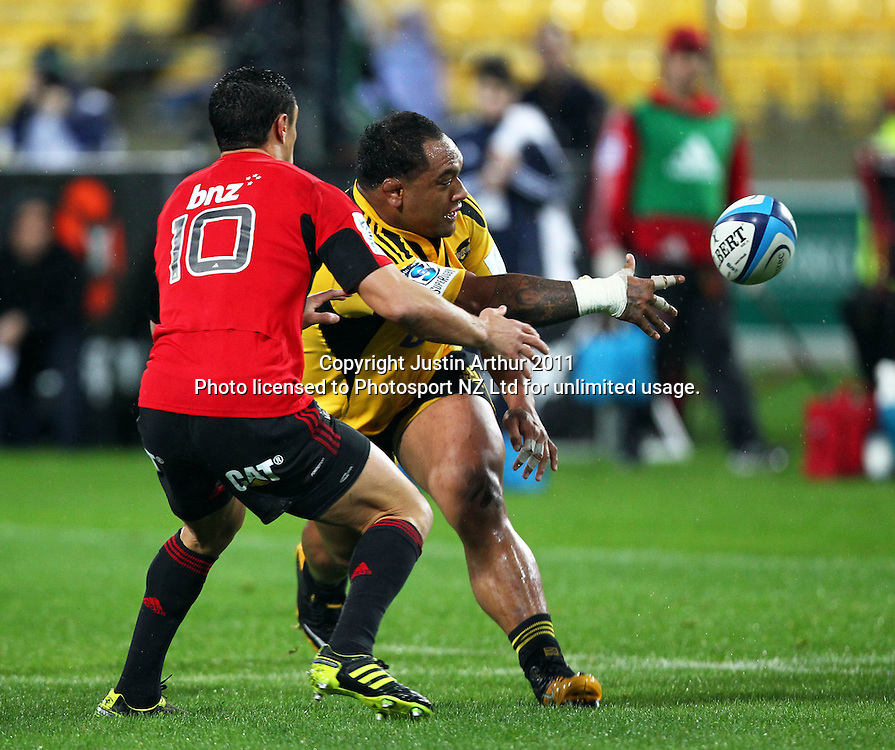 Neemia Tialata off loads .Super15 rugby union match - Crusaders v Hurricanes at Westpac Stadium, Wellington, New Zealand on Saturday, 18 June 2011. Photo: Justin Arthur / photosport.co.nz