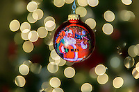 More fun with ornaments in front of the tree