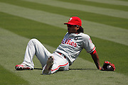 LOS ANGELES, CA - AUGUST 10:  Michael Martinez #19 of the Philadelphia Phillies lies on the grass before the game against the Los Angeles Dodgers on August 10, 2011 at Dodger Stadium in Los Angeles, California. The Phillies won the game 9-8. (Photo by Paul Spinelli/MLB Photos via Getty Images) *** Local Caption *** Michael Martinez