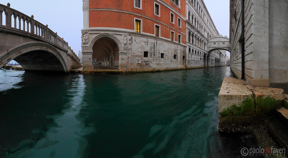 An early morning view of Rio di Palazzo, the Canal between Doge's Palace and the Prigioni Nuove (New Jail), with the Bridge of Sighs in the background. Taken on a misty morning of mid January, this is stitched from six vertical frames.
