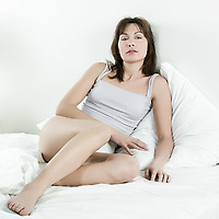 young beautiful woman  in her bedroom