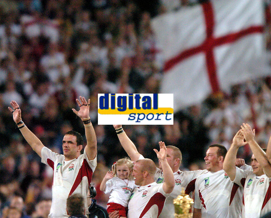 Photo: Richard Lane.<br />Australia v England. Rugby World Cup Final, at the Telstra Stadium, Sydney. RWC 2003. 22/11/2003. <br />England (lt to rt), Martin Johnson, Neil Back with daughter Olivia, Phil Vickery, Steve Thompson and Trevor Woodman celebrate winning the Rugby World Cup.