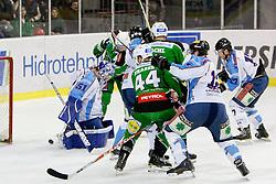 Players of HDD Tilia Olimpija celebrate during ice-hockey match between HDD Tilia Olimpija and SAPA Fehervar AV19 at second match in Quarterfinal  of EBEL league, on Februar 21, 2012 at Hala Tivoli, Ljubljana, Slovenia. HDD Tilia Olimpija won 2:1 in OT. (Photo By Matic Klansek Velej / Sportida)