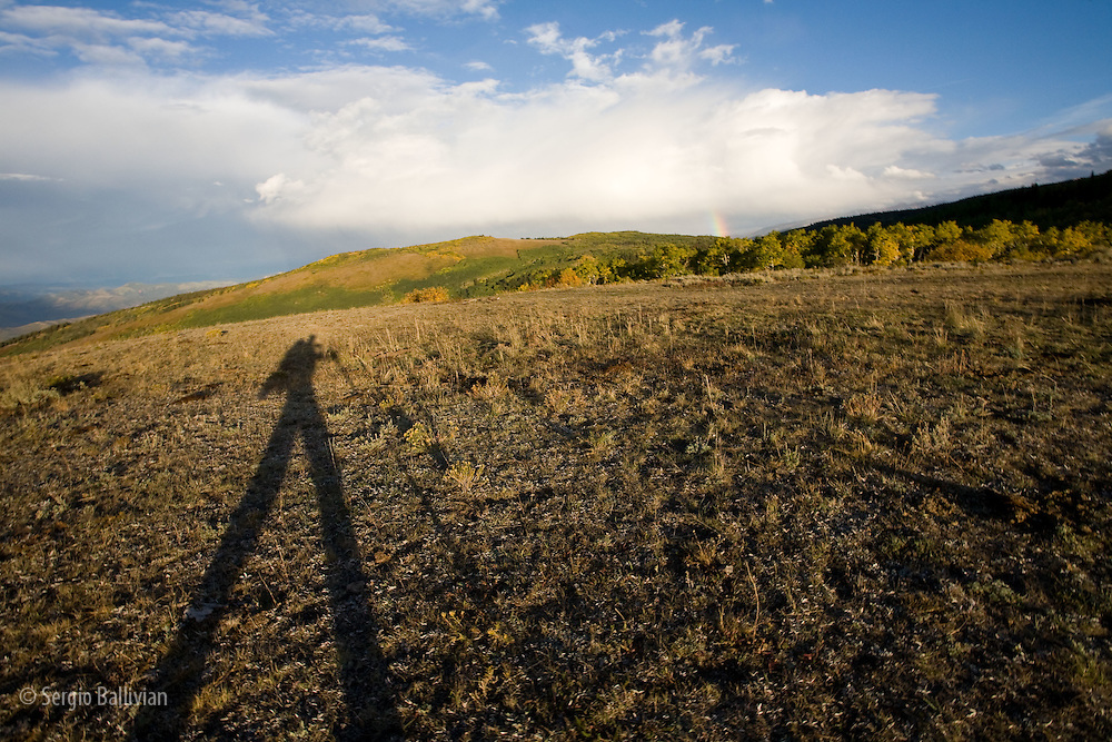 Shadow of hiker/photographer while trekking to Mt Sopris near Carbondale, Colorado.