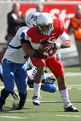 19 October 2013:  Phil Dudley tackled by Clay Guess during an NCAA football game between the Indiana State Sycamores and the Illinois State Redbirds at Hancock Stadium in Normal IL