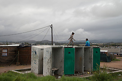Children play on top of vandalized ablution facilities, in Jamestown, which is located in the Cape Winelands, one of the districts in the Western Cape that has been designated a hotspot area, in terms of people testing positive for COVID-19. When South Africa moves down to Stage 3 of the nationwide lockdown on June 1st, hotspots areas will remain under stricter regulations and surveillance, per the latest government announcements. PHOTO: EVA-LOTTA JANSSON