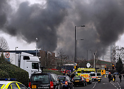 © Licensed to London News Pictures. 31/01/2012, London, UK. A huge fire, thought to be in an old dairy building containing small business is causing road and tube closures in Wood Lane, West London today 31 January 2012.  A large number of Fire Brigade and London Ambulance are in attendance. Photo credit : Stephen Simpson/LNP