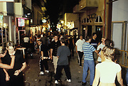 People partying at a street in Ibiza, 1999.