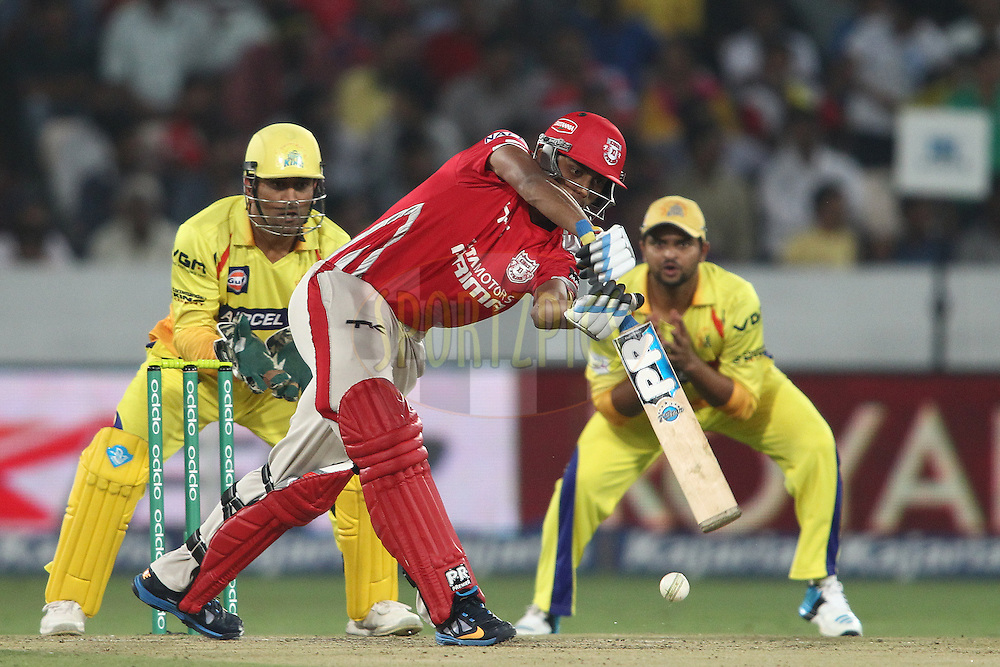 Akshar Patel of the Kings XI Punjab pushes a delivery to the on side during the second semi final match of the Oppo Champions League Twenty20 between the Kings XI Punjab and the Chennai Superkings held at the Rajiv Gandhi Cricket Stadium, Hyderabad, India on the 2nd October 2014<br /> <br /> Photo by:  Shaun Roy / Sportzpics/ CLT20<br /> <br /> <br /> Image use is subject to the terms and conditions as laid out by the BCCI/ CLT20.  The terms and conditions can be downloaded here:<br /> <br /> http://sportzpics.photoshelter.com/gallery/CLT20-Image-Terms-and-Conditions-2014/G0000IfNJn535VPU/C0000QhhKadWcjYs