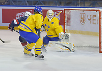DMITROV, RUSSIA - JANUARY 13: Sweden's Miranda Dahlgren #1 makes a glove save against USA's Dominique Petrie #11 while Nathalie Lidman #8 looks on during gold medal game action at the 2018 IIHF Ice Hockey U18 Women's World Championship. (Photo by Steve Kingsman/HHOF-IIHF Images)