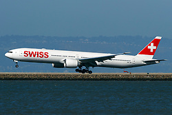 Boeing 777-3DE(ER) (HB-JNI) operated by Swiss landing at San Francisco International Airport (KSFO), San Francisco, California, United States of America