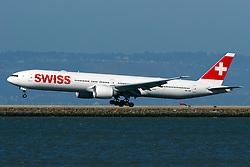 Boeing 777-3DE(ER) (HB-JNI) operated by Swiss landing at San Francisco International Airport (KSFO), San Francisco, California, United States of America