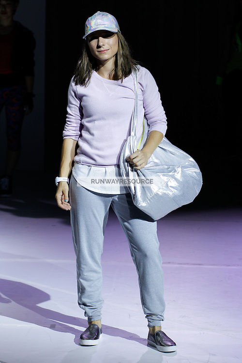 A model dances wearing Athleta Spring 2015 during Mecedes-Benz Fashion Week in New York on September 3rd, 2014