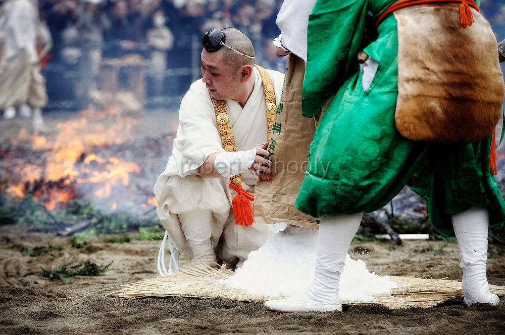 The purification ceremony in which participants walk barefoot across burning embers in Takao, west of Tokyo, Japan on Sunday 09 March  2009.