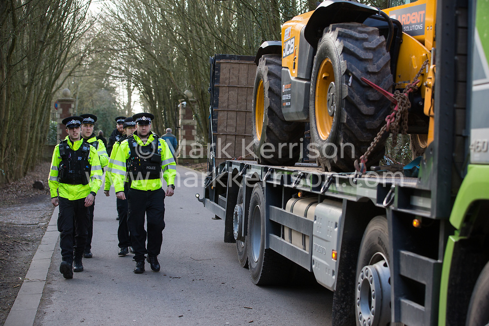 Denham, UK. 11 February, 2020. Thames Valley Police officers arrive to arrest environmental activists from Extinction Rebellion who had been 'slow walking' in front of a large truck delivering a JCB forklift truck to a HS2 site. Contractors working on behalf of HS2 are rerouting electricity pylons through a Site of Metropolitan Importance for Nature Conservation (SMI) in conjunction with the high-speed rail link.