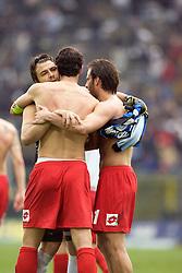 Alexandre Frey and Gilardino embrace. Fiorentina during the Serie A match between Atalanta and Fiorentina at the Stadio in Bergamo, Italy