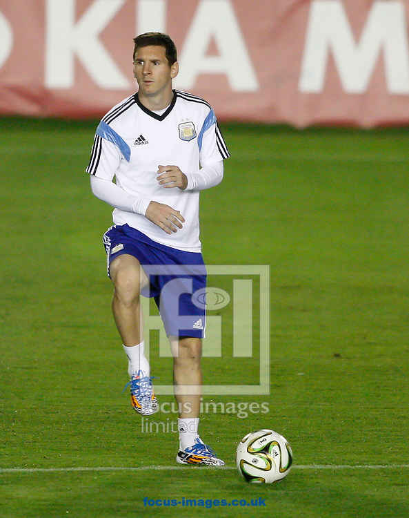 Lionel Messi (captain) of Argentina warms up during the Argentina training session at the Est&aacute;dio S&atilde;o Janu&aacute;rio, Rio de Janeiro, ahead of tomorrow's World Cup Final.<br /> Picture by Andrew Tobin/Focus Images Ltd +44 7710 761829<br /> 12/07/2014