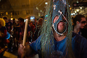 New York, NY, October 31, 2013. Photographer Jason Gardner wearing  a Brazillian-style mask and holding a drumstick in New York's Greenwich Village Halloween Parade. Gardner recently published a book on Pernambuco's Carnaval.
