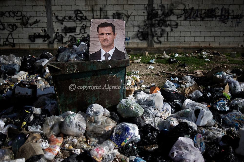 SYRIA - Al Qsair. A portait of Al Assad putted on rubbish in Al Qsair, on February 10, 2012. ALESSIO ROMENZI
