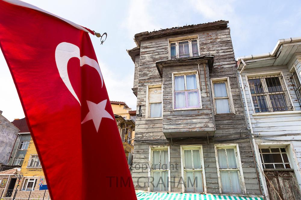 Turkish flag and traditional architecture of homes in the area of Kariye Muzesi, Edirnekapi in Istanbul, Republic of Turkey