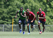 Eddie Johnson (l) leads Cory Gibbs (center) and Eddie Pope (r) in a fitness exercise on Wednesday, May 17th, 2006 at SAS Soccer Park in Cary, North Carolina. The United States Men's National Soccer Team held a training session as part of their preparations for the upcoming 2006 FIFA World Cup Finals being held in Germany.