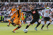 Hull midfielder Ahmed Elmohamady strikes at goal during the Sky Bet Championship play-off first leg match between Derby County and Hull City at the iPro Stadium, Derby, England on 14 May 2016. Photo by Aaron  Lupton.