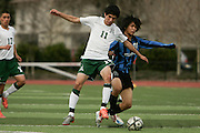 Alisal's Juan Iturbe, left, and Bellarmine's Austin Chun go for the ball during the first half of Saturday's Central Coast Section Div-1 championship game at Oak Grove High School in San Jose. Alisal won the championship 3-1.