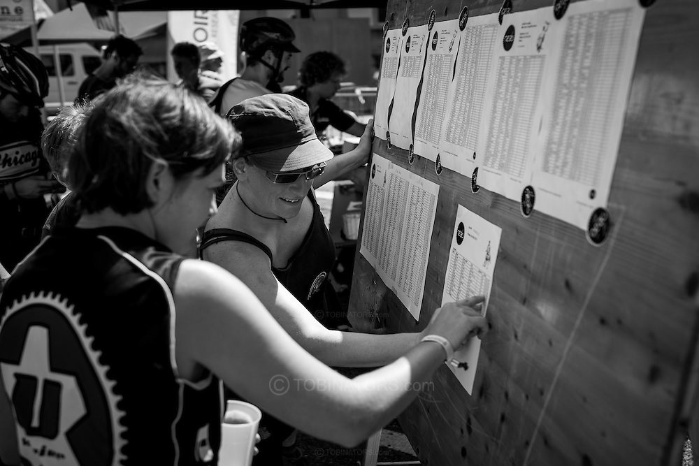 Picture by Andrew Tobin/Tobinators Ltd +44 7710 761829<br /> 04/08/2013<br /> Riders check their times during the Cycle Messenger World Championships held in Lausanne, Switzerland. Started in 1993 by Achim Beier from Berlin, the championships are not only a sporting contest but an opportunity to unite friends and bicycle enthusiasts worldwide. The event comprises a number of challenges including a sprint, a track stand (longest time stationary on the bike), a cargo race where heavy loads are carried on special bikes, and the main race. The course winds through central Lausanne and includes bridges, stairs, cobbles, narrow alleyways and challenging hills. The main race simulates the job of a bike courier making numerous drops and pickups across the city. Riders need to check in at specific checkpoints, hand over their delivery and get a new one. The main race can take up to 4 hours for each competitor to complete.