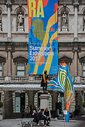 A Yinka Shonibare six metre high colourful wind sculpture in the RA Courtyard - The Royal Academy's 249th Summer Exhibition - co-ordinated by Eileen Cooper RA. The hanging committee will consist of Royal Academicians Ann Christopher, Gus Cummins, Bill Jacklin, Fiona Rae, Rebecca Salter and Yinka Shonibare (with show branding based on his work). This year, the Architecture Gallery will be curated by Farshid Moussavi RA. The exhibition is open to the public 13 June – 20 August 2017. London 07 June 2017.