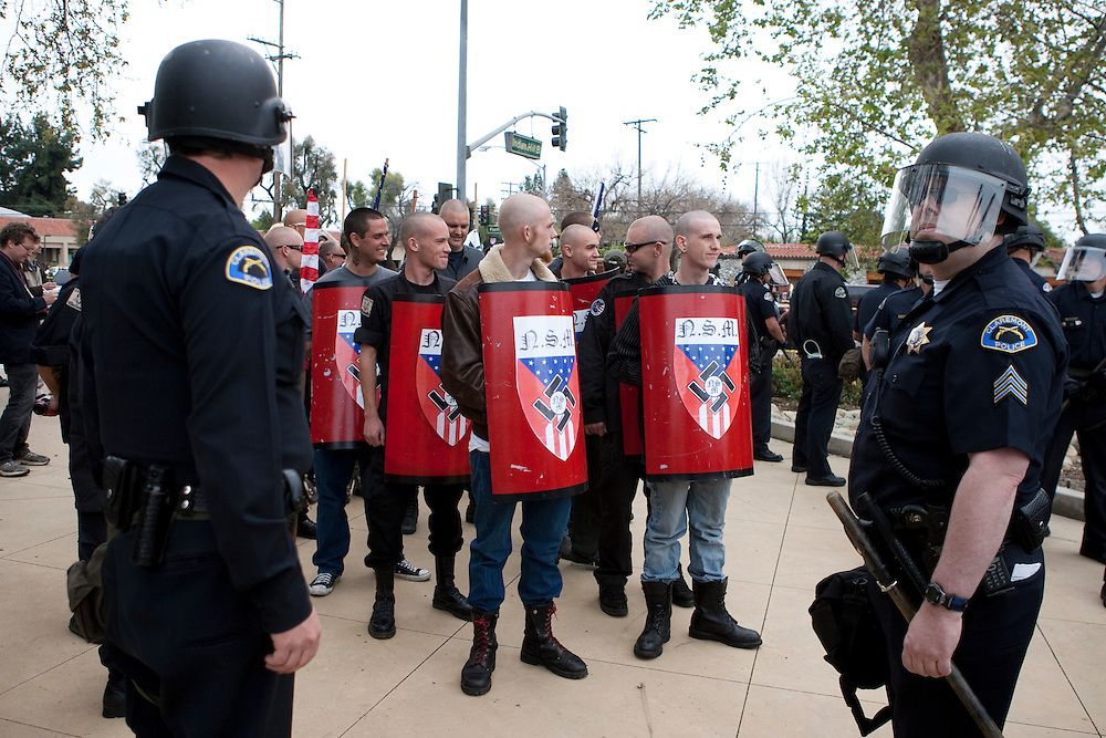 Members of the National Socialist Movement, a Neo Nazi group, rallies in Claremont, California against illegal immigration. Police ready to escort the NSM out of the demonstration zone to protect against confrontation with counter protesters. Please contact Todd Bigelow directly with your licensing requests.