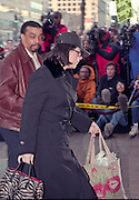 Former White House intern Monica Lewinsky is escorted into the Mayflower Hotel January 30, 1999 after arriving in Washington, DC. Lewinsky will be deposed by House prosecutors in President Clinton's impeachment trial on February 1.